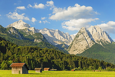 Hay barns at Hammersbach Footpath against Wetterstein Mountain Range, Garmisch-Partenkirchen, Werdenfelser Land, Upper Bavaria, Germany, Europe