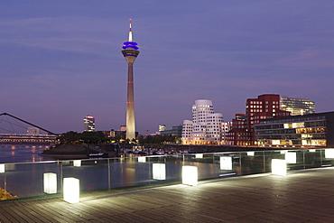 Media Harbour (Medienhafen), Neuer Zollhof building designed by Frank Gehry and Rhineturm tower, Dusseldorf, North Rhine Westphalia, Germany, Europe