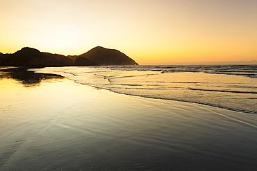 Wharariki Beach at sunset, Golden Bay, Tasman, South Island, New Zealand, Pacific