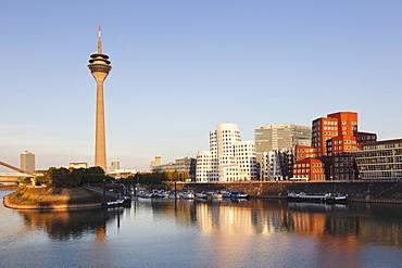 Neuer Zollhof, designed by Frank Gehry, Rheinturm tower, Media Harbour (Medienhafen), Dusseldorf, North Rhine Westphalia, Germany, Europe