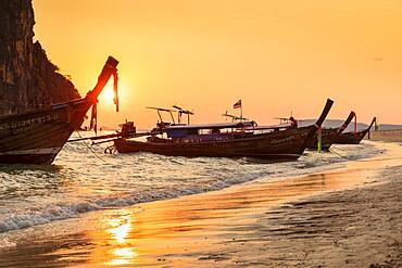 Longtail boats at Phra Nang Beach at sunset, Rai Leh Peninsula, Krabi Province, Thailand, Southeast Asia, Asia