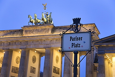 Brandenburg Gate (Brandenburger Tor) and Quadriga winged victory and road sign Pariser Platz, Unter den Linden, Berlin, Germany, Europe