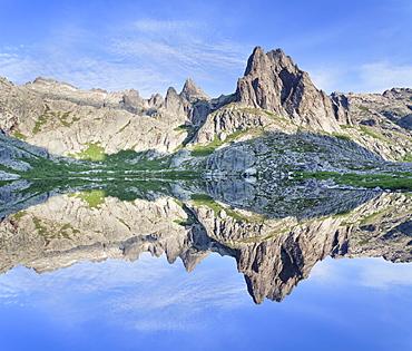 Pic Lombarduccio reflecting in Lac de Melo, Gorges de la Restonica, Haute Corse, Corsica, France, Europe