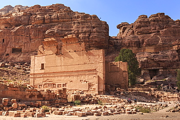 Local men on donkeys pass Qasr al-Bint temple, City of Petra ruins, Petra, UNESCO World Heritage Site, Jordan, Middle East