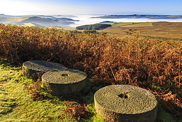 Millstones, bracken, fog of temperature inversion, Stanage Edge, early autumn, Peak District National Park, Derbyshire, England, United Kingdom, Europe