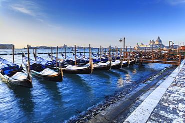 Gondolas with view to Basilica di Santa Maria della Salute after snow, Venice, UNESCO World Heritage Site, Veneto, Italy, Europe