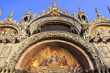 Basilica San Marco golden exterior mosaics in late afternoon sun in winter, Venice, UNESCO World Heritage Site, Veneto, Italy, Europe