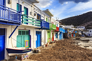 Syrmata, traditional fishermen's encampments with brightly painted woodwork, fishing village of Klima, Milos, Cyclades, Greek Islands, Greece, Europe