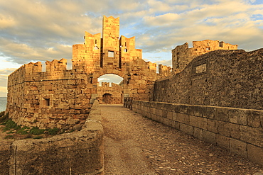 Liberty Gate at sunset, Medieval Old Rhodes Town, UNESCO World Heritage Site, Rhodes, Dodecanese, Greek Islands, Greece, Europe