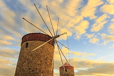 Mandraki Harbour medieval windmills at sunset, Rhodes, Dodecanese, Greek Islands, Greece, Europe