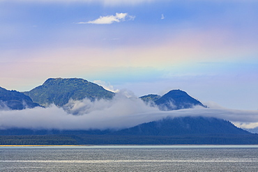 Rainbow colours and low hanging mist over Icy Strait, between Chichagof Island and Glacier Bay National Park, UNESCO World Heritage Site, Alaska, United States of America, North America