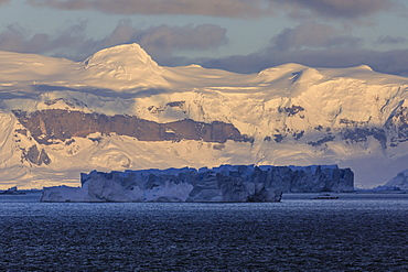 Sunrise, with atmospheric cloud and mist, mountains, glaciers and icebergs, Andvord Bay, Graham Land, Antarctica, Polar Regions