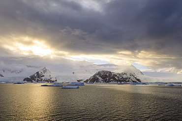 Sunrise, with atmospheric cloud and mist, mountains, glaciers and icebergs, Neko Harbour, Andvord Bay, Graham Land, Antarctica, Polar Regions
