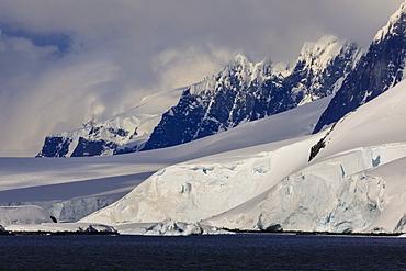 Glaciers, mountain peaks and dramatic clouds and sky, Cape Errera, Wiencke Island, Antarctic Peninsula, Antarctica, Polar Regions