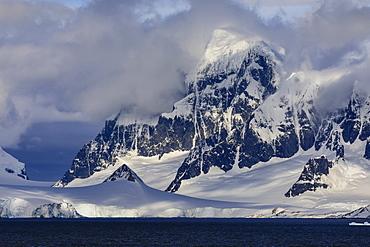Glaciers and mountains of Cape Errera with dramatic sky, Wiencke Island, from Bismarck Strait, Antarctic Peninsula, Antarctica, Polar Regions