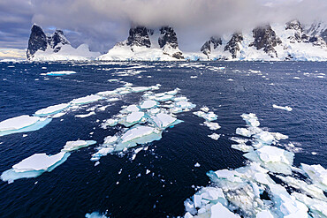 Sea ice off Una Peaks and False Cape Renard, Lemaire Channel entrance, Antarctic Peninsula, Antarctica, Polar Regions