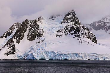 Mountains and glaciers of False Cape Renard, Lemaire Channel entrance, evening light, Antarctic Peninsula, Antarctica, Polar Regions