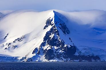 Livingston Island mountains in low lying mist, evening sun, from Bransfield Strait, South Shetland Islands, Antarctica, Polar Regions