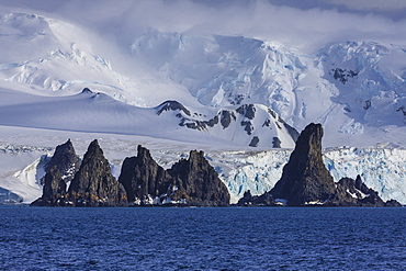 Pinnacle rocks, glaciers, mountains of Greenwich Island, from the sea, bright, misty weather, South Shetland Islands, Antarctica, Polar Regions