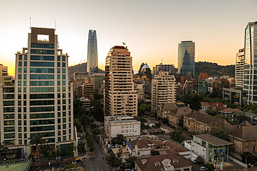 Sunset, Sanhattan and Gran Torre Santiago, South America's tallest building, from El Golf area, Las Condes, Santiago, Chile, South America
