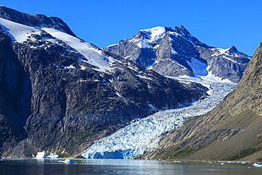 Mountains and tidewater glacier, rugged South Skjoldungen Fjord and Island, glorious weather, remote South East Greenland, Denmark, Polar Regions