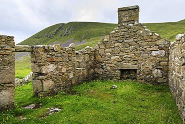 Stone remains of evacuated cottage with fireplace, Hirta, remote St. Kilda Archipelago, UNESCO World Heritage Site, Outer Hebrides, Scotland, United Kingdom, Europe