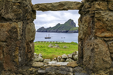 Village Bay through stone remains of evacuated village, Hirta, St. Kilda Archipelago, UNESCO World Heritage Site, Outer Hebrides, Scotland, United Kingdom, Europe