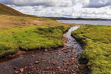 Little Ayre, burn, red sand and granite beach and rocks, Muckle Roe Island, Shetland Isles, Scotland, United Kingdom, Europe