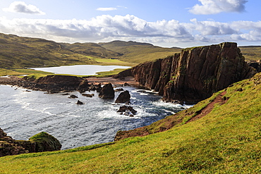 North Ham Bay, deep inlet, elevated view, red granite cliffs, stacks, Town Loch, Muckle Roe Island, Shetland Isles, Scotland, United Kingdom, Europe