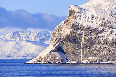 Spectacular snow covered mountains in winter, Troms islands, from the Norwegian Sea, Arctic Circle, North Norway, Europe