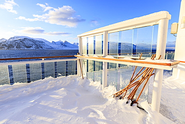 Cruise ship on an Arctic Winter voyage, deep fresh powder snow on decks, off Troms County, North Norway, Scandinavia, Europe