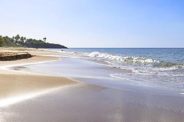 Tropical Anse de la Perle beach, backlit people, golden sand, Death In Paradise location, Deshaies, Guadeloupe, Leeward Islands, West Indies, Caribbean, Central America