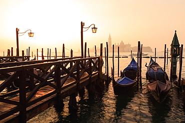 Venetian sunrise, winter fog, gondolas, San Giorgio Maggiore and Lido, Venice, UNESCO World Heritage Site, Veneto, Italy, Europe