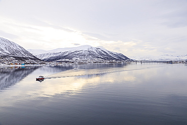 Tromso city, from its fjord, city covered in winter snow, boat, Arctic Cathedral, bridge, mountains, Tromso, Troms og Finnmark, North Norway, Scandinavia, Europe