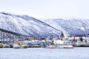 Tromso, small boat harbour, fjord, bridge, Arctic Cathedral, deep snow in winter, Tromso, Troms og Finnmark, Arctic Circle, North Norway, Scandinavia, Europe