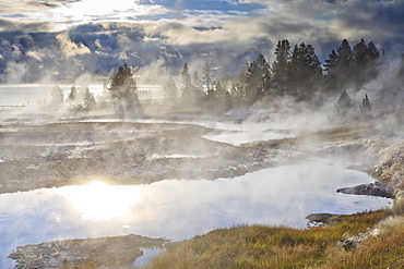 Freezing mists and thermal features, dawn, West Thumb Geyser Basin, Yellowstone National Park, UNESCO World Heritage Site, Wyoming, United States of America, North America