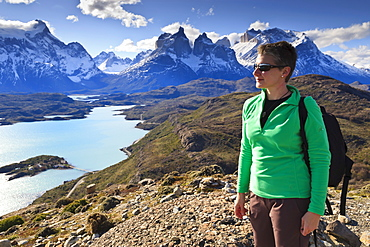 Hiker at Condor Vista Point, Lago Pehoe and the Cordillera del Paine, Torres del Paine National Park, Patagonia, Chile, South America