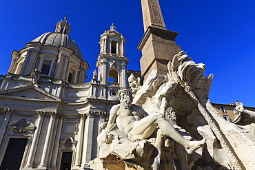 Fontana dei Quattro Fiumi, topped by the Obelisk of Domitian with the Sant'Agnese in Agone, Piazza Navona, Rome, Lazio, Italy, Europe