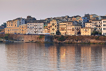 Summer sunrise on the waterfront, Old Town from the sea, Corfu Town, UNESCO World Heritage Site, Corfu, Ionian Islands, Greek Islands, Greece, Europe