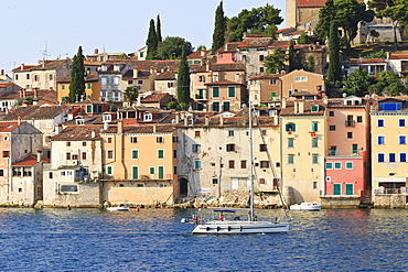 Yacht and Old Town from the sea on a summer's early morning, Rovinj (Rovigno) peninsula, Istria, Croatia, Europe