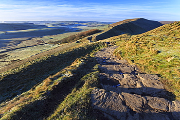 Steps up Mam Tor, view towards Rushup Edge, distant fields and hills in winter, Castleton, Peak District, Derbyshire, England, United Kingdom, Europe