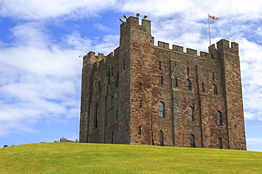 Bamburgh Castle, The Keep, with English flag of St. George, Bamburgh, Northumberland, England, United Kingdom, Europe