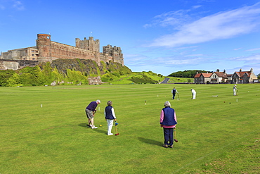 Playing croquet beneath Bamburgh Castle on a bright summer afternoon, Bamburgh, Northumberland, England, United Kingdom, Europe