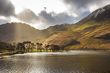 Shafts of light break through clouds to illuminate the fells in winter, Buttermere, Lake District National Park, Cumbria, England, United Kingdom, Europe
