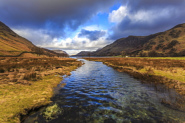 Warnscale Beck flows to Buttermere, from Peggy's Bridge in winter, Lake District National Park, Cumbria, England, United Kingdom, Europe