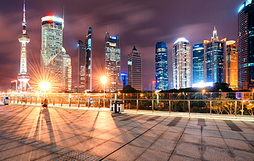 Cityscape Shanghai Lujiazui with Oriental Pearl Tower, skyscrapers and bright lights at night, Shanghai, China, Asia