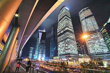 Wide angle view of ultra modern architecture in Shanghai Pudong at night, Shanghai, China, Asia