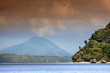 View of the cone of Gunung Api Wetar volcano from Nailaka island, Banda Islands, Maluku, Spice Islands, Indonesia, Southeast Asia, Asia