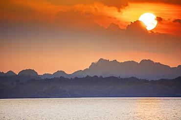 Sunset over limestone karst islands, Raja Ampat, West Papua, Spice Islands, Indonesia, Southeast Asia, Asia