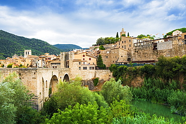The medieval bridge and fortified old stone city of Besalu in the foothills of the Pyrenees, Besalu, Girona, Catalonia, Spain, Europe